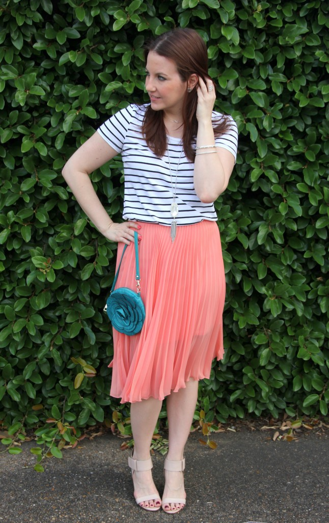 summer outfit idea striped tee with pleated midi skirt lady in