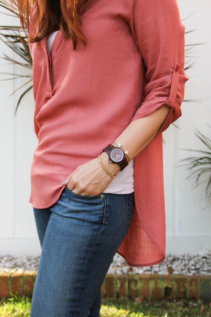coral tunic with jeans