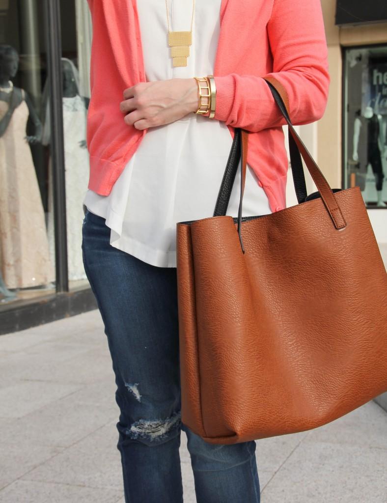 baublebar bracelets and a brown tote bag
