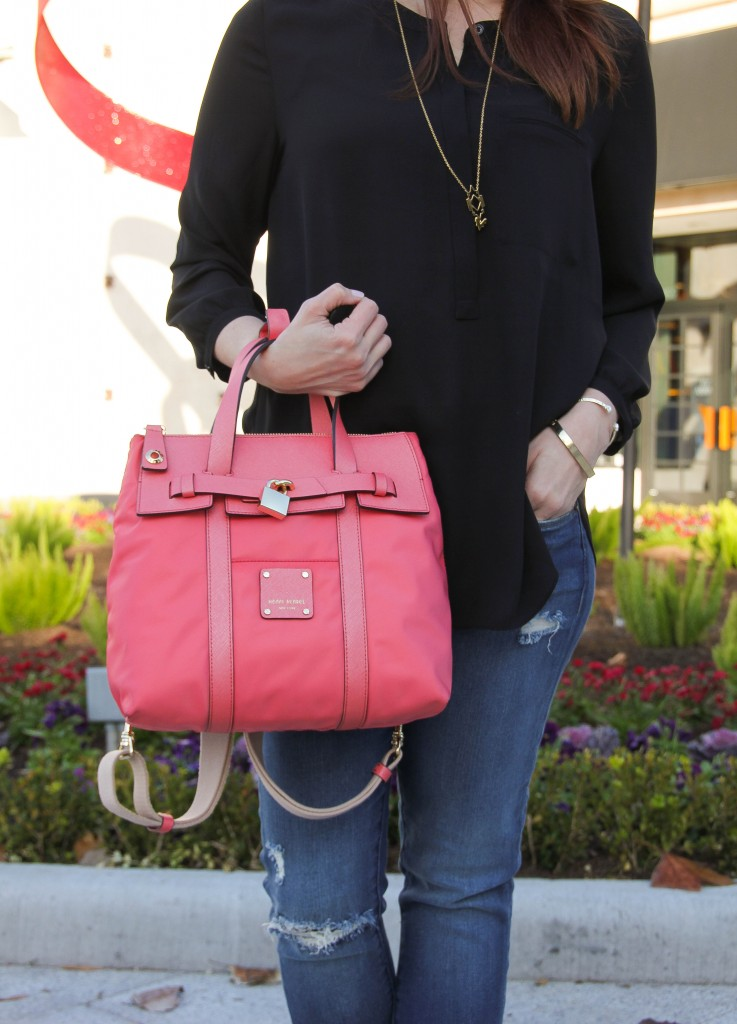 Pink Purse and black blouse