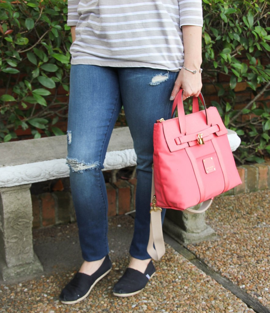 distressed denim and toms with henri bendel mini jetsetter