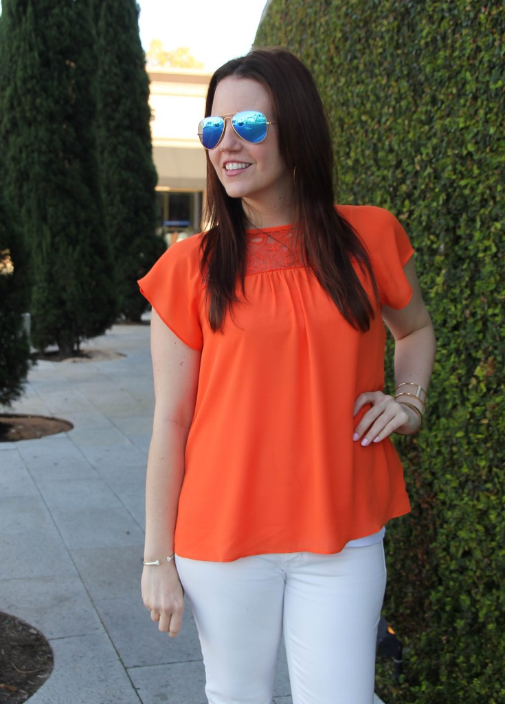 summer orange top with white skinny jeans