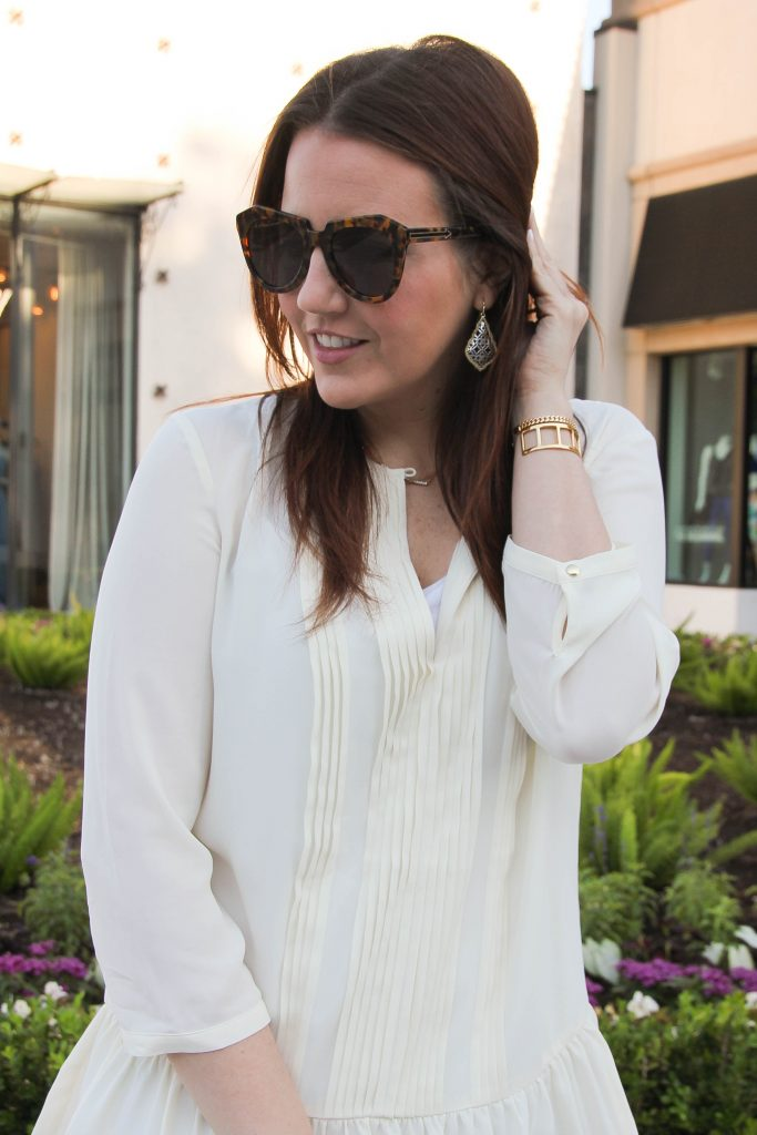 kendra scott earrings and karen walker oversized sunglasses