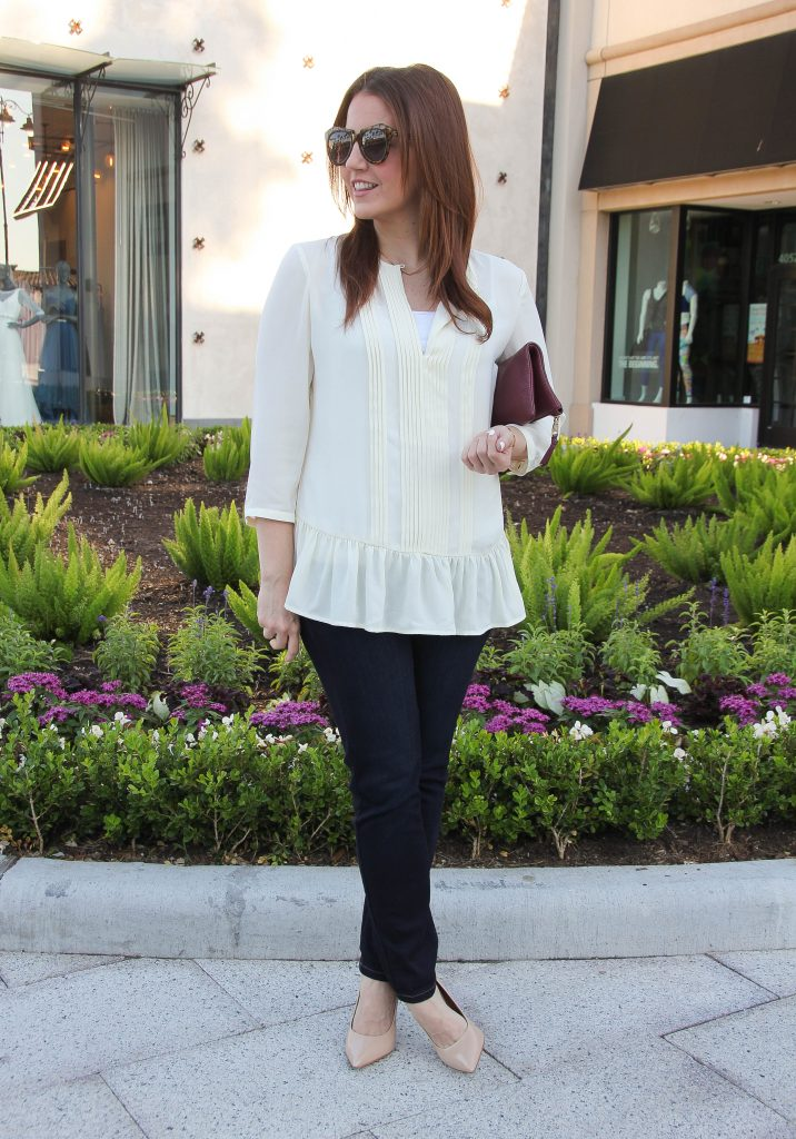 fall outfit - ruffle blouse and dark jeans with heels