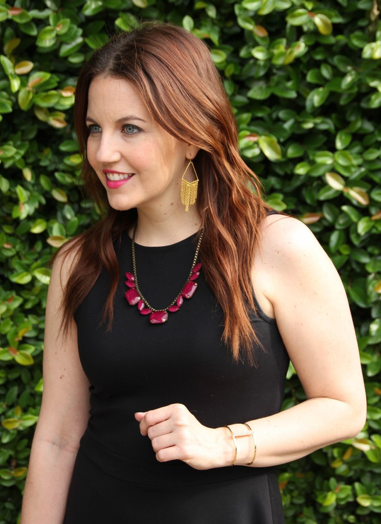 gold fringe earrings and maroon necklace