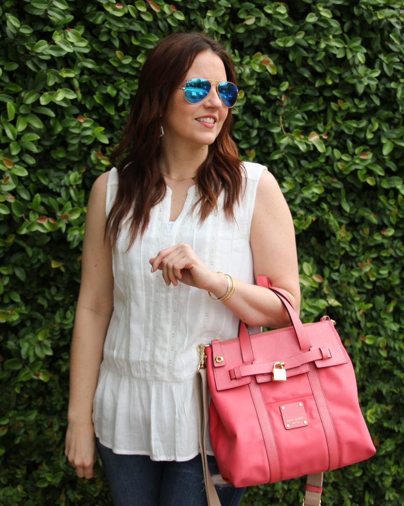eyelet white top with ruffle and pink purse