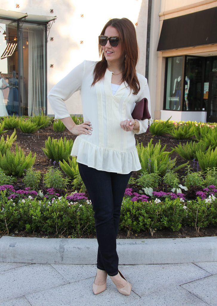 dressed up casual outfit with ruffle blouse and dark jeans