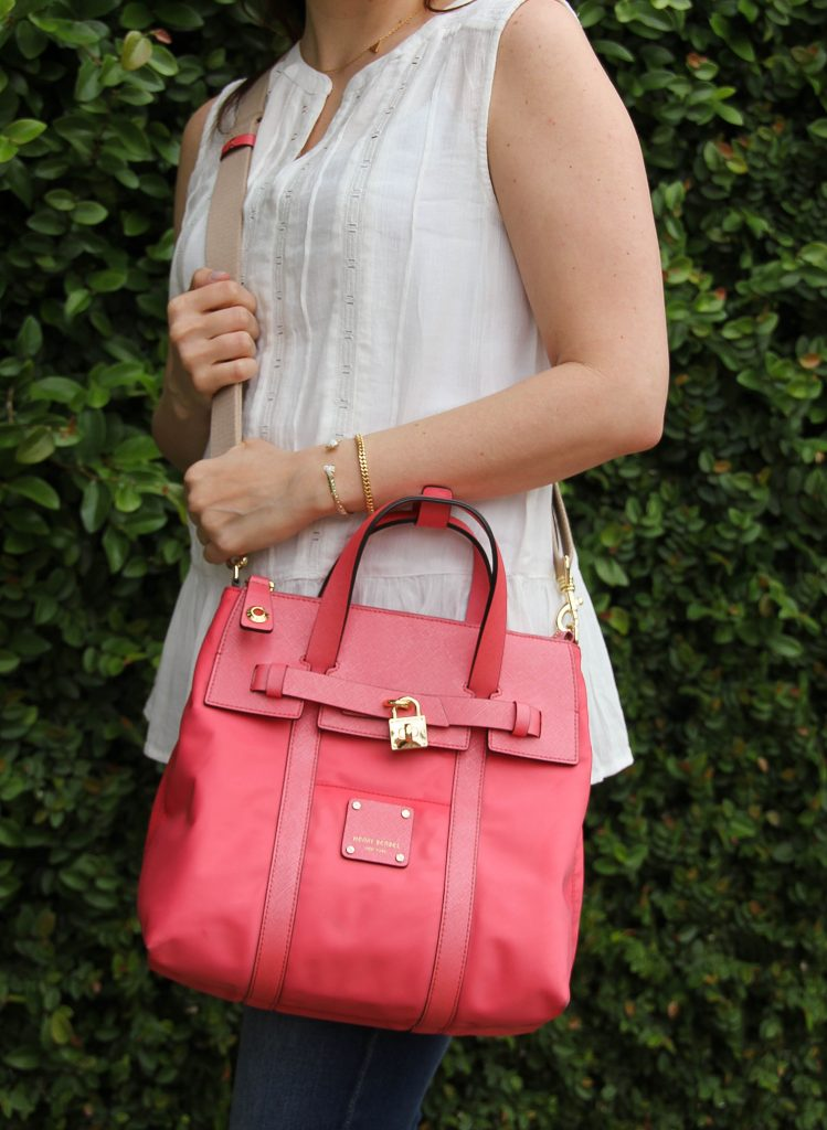 sleeveless white blouse and pink crossbody bag