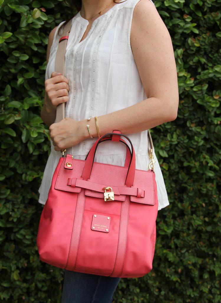 sleeveless white blouse and pink crossbody bag