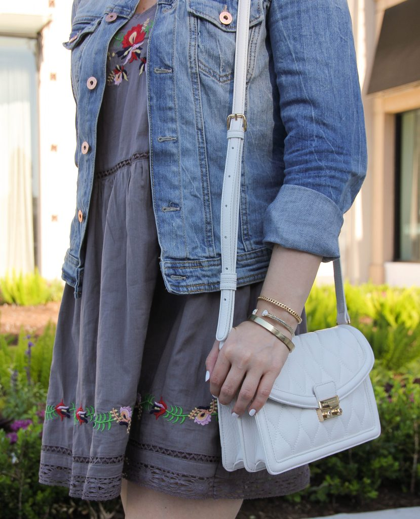 White purse and embroidered dress with flowers