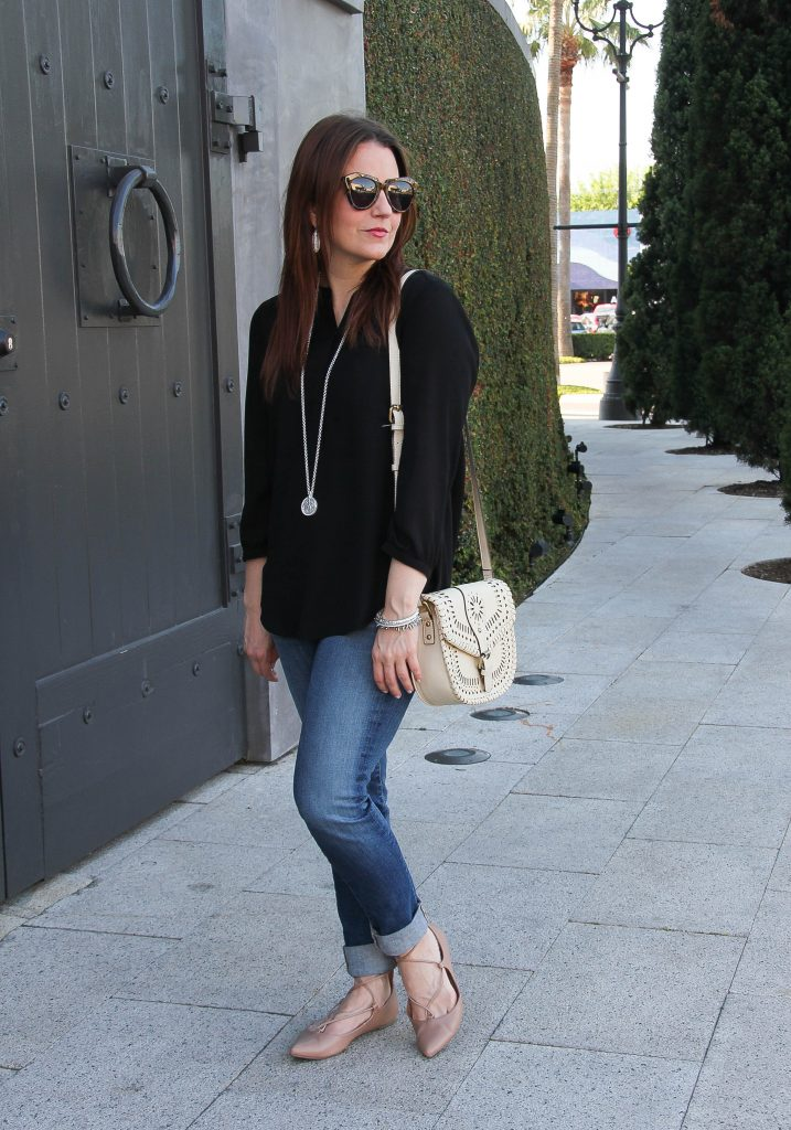 spring outfit idea - black top and jeans with flats