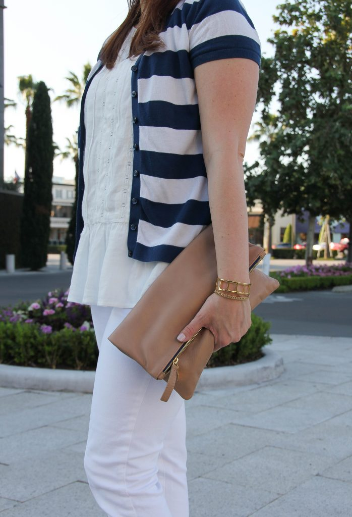 clare v foldover clutch and gold bracelets