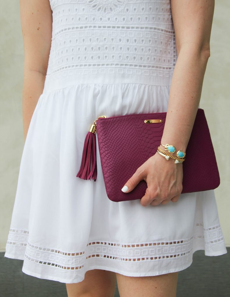 gold bracelets with white and turquoise and magenta clutch