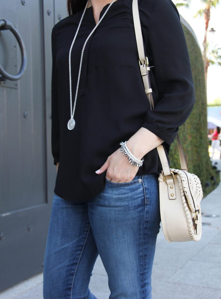 silver jewelry and crossbody bag