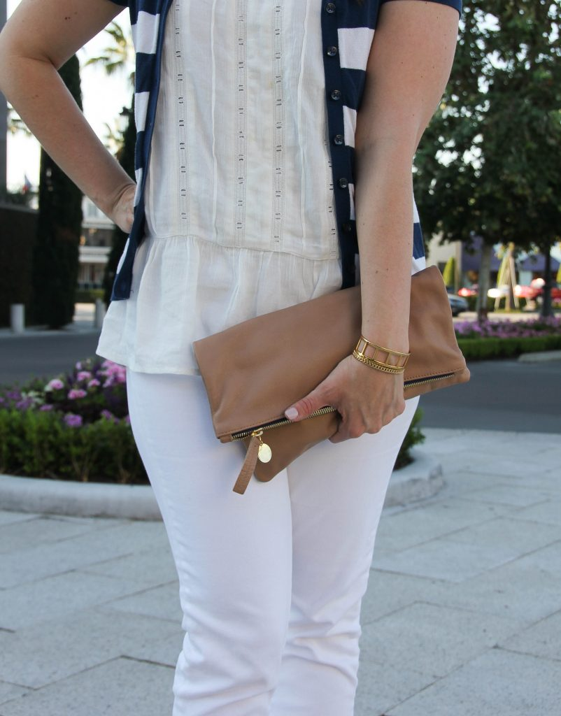 foldover clutch with an all white outfit for work