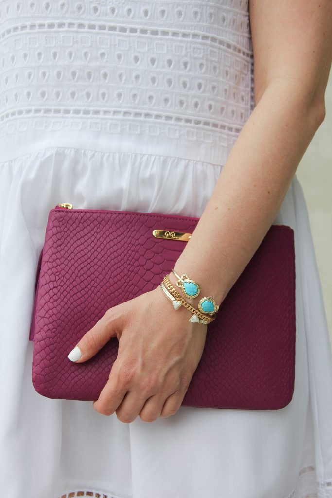 kendra scott turquoise bracelet and pink purse