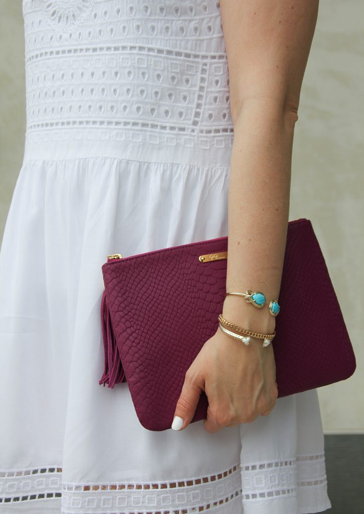 kendra scott andy bracelet in turquoise and pink clutch