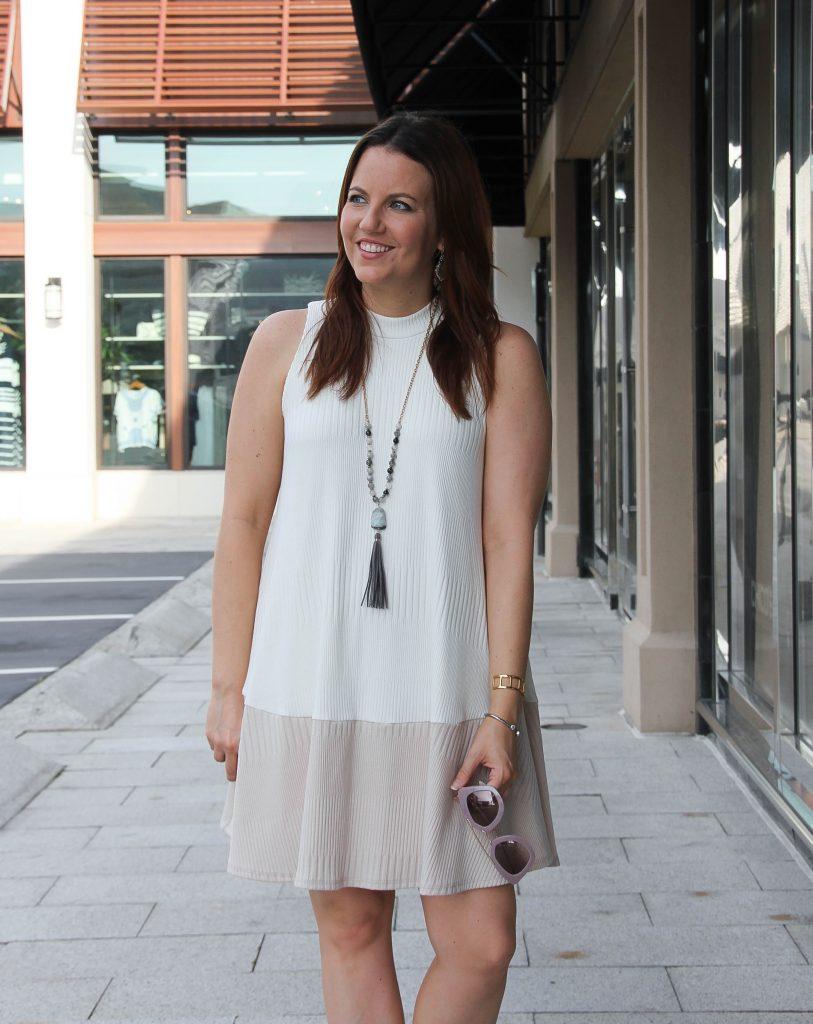 sleeveless white knit dress
