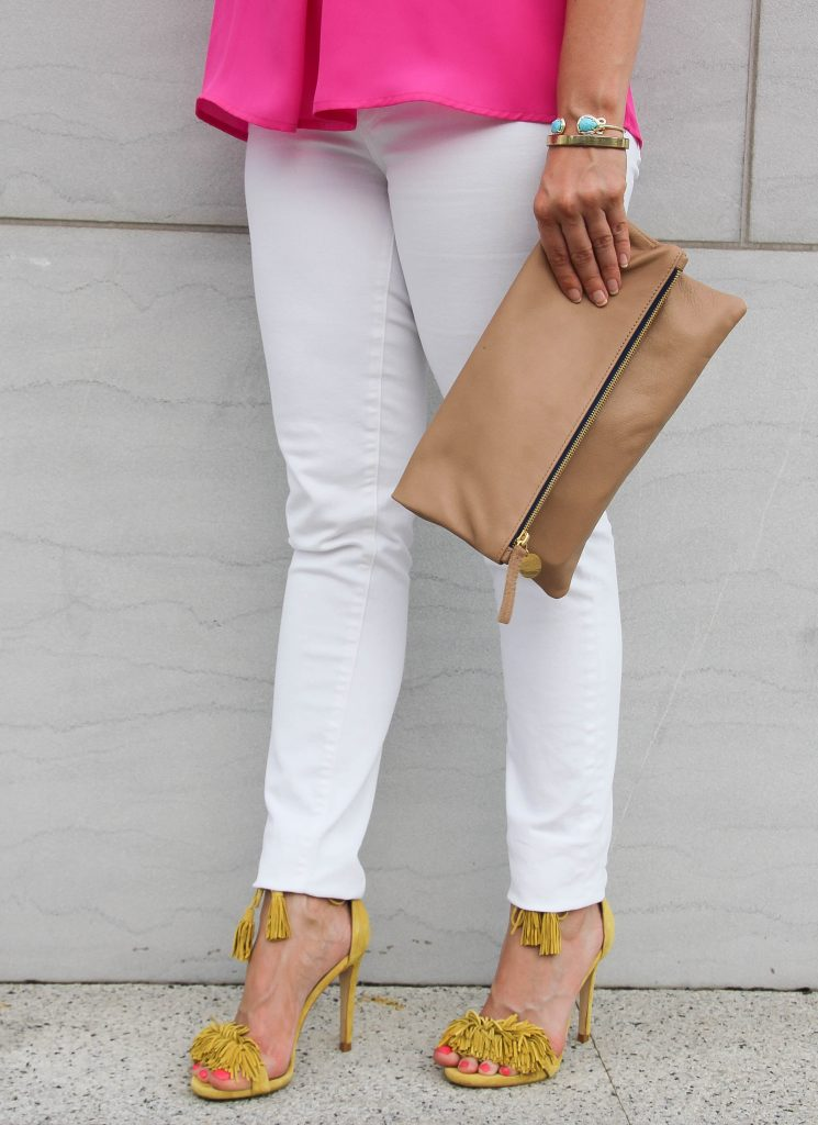 yellow fringe sandals and white skinny jeans