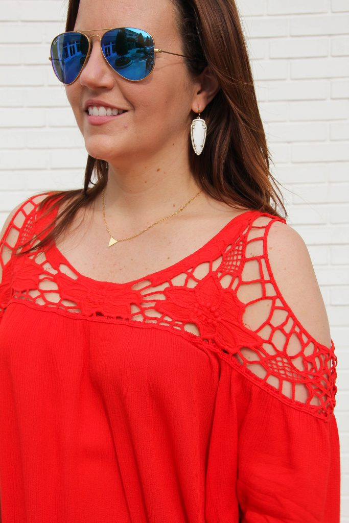 pairing a red cold shoulder top with blue mirrored aviators for summer