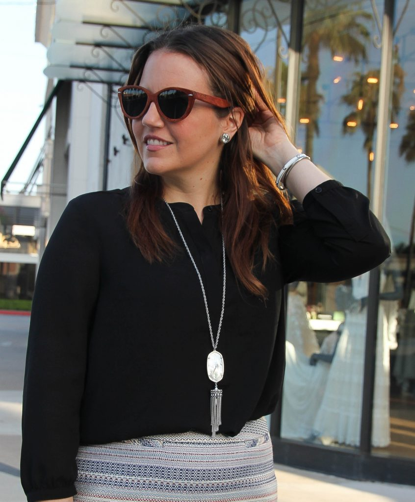 long tassel pendant necklace and silver stud earrings