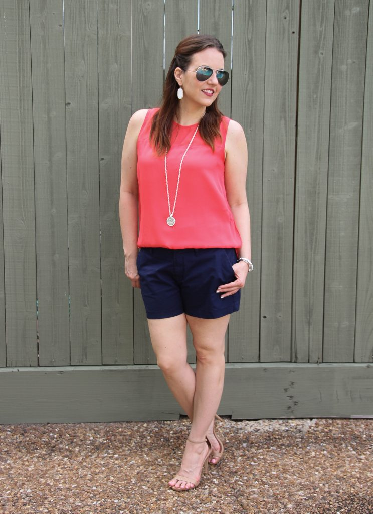 coral sleeveless blouse navy cotton shorts heels
