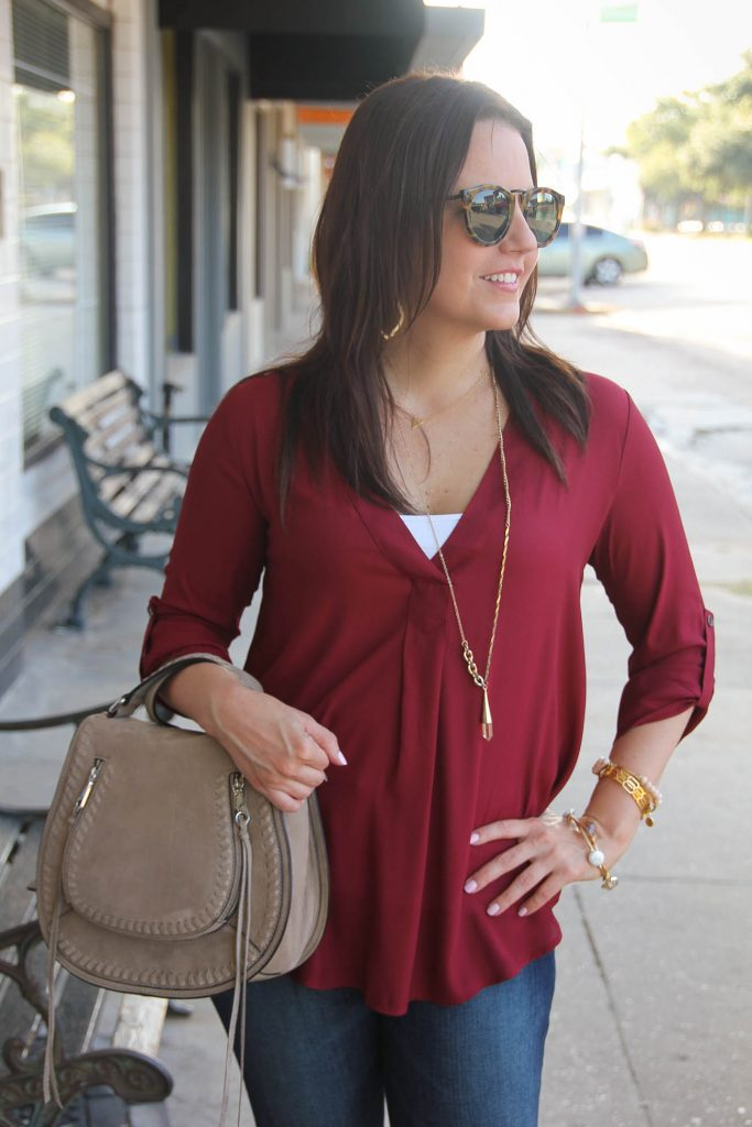 burgundy blouse with gold jewelry