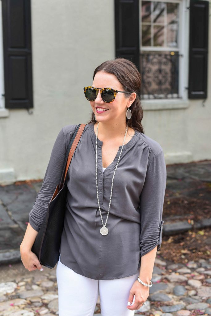 gray lightweight blouse with long coin pendant necklace