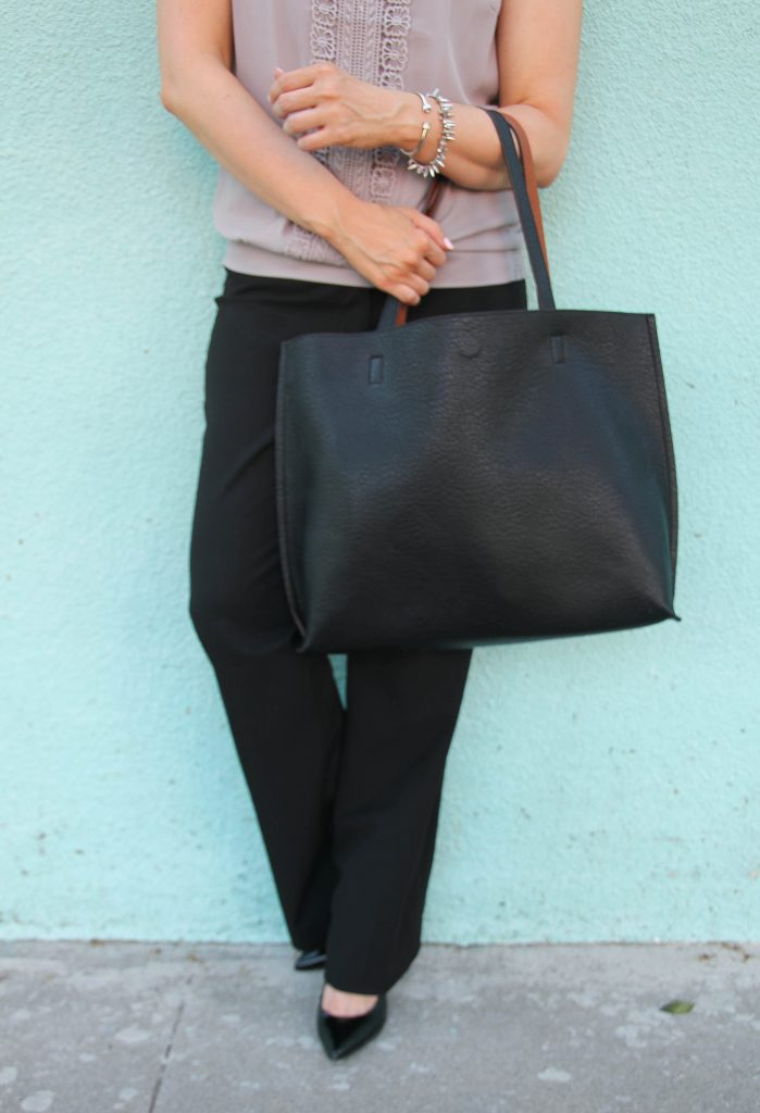 black trousers and black tote bag