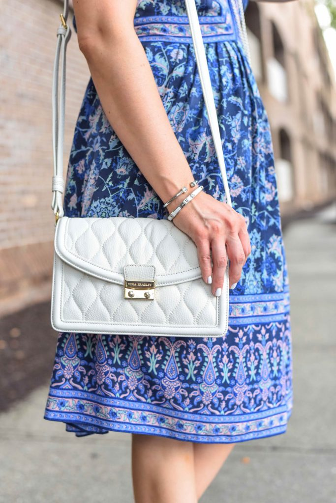 white quilted crossbody bag and cute silver bracelets