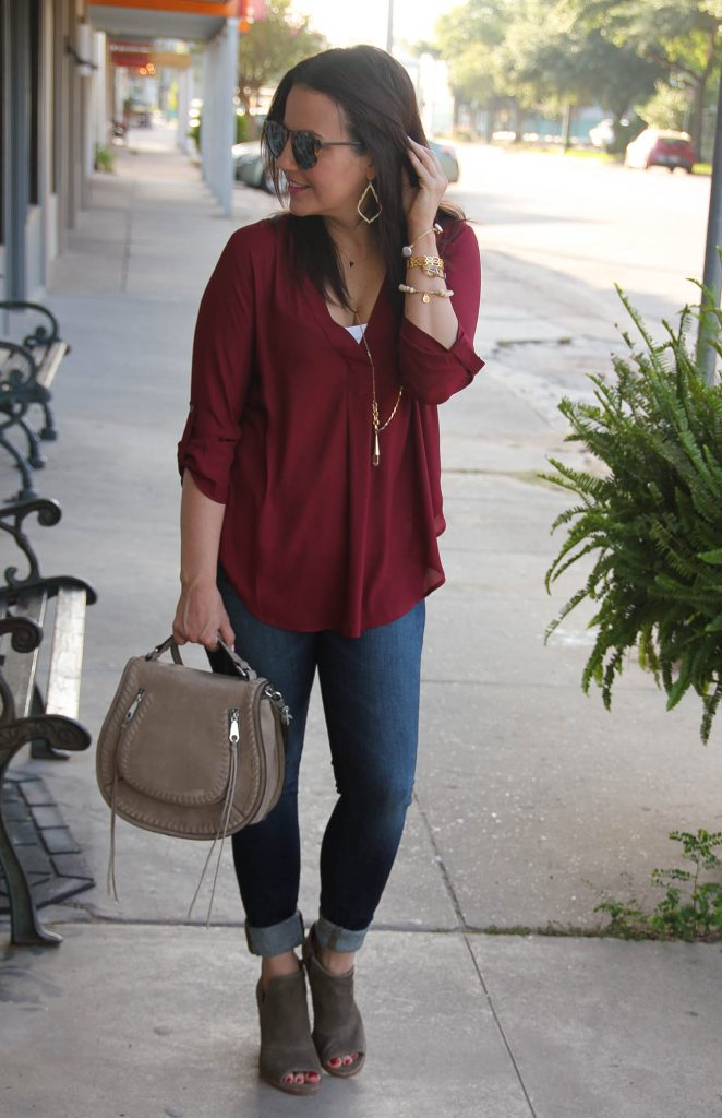 fall outfit ideas vneck blouse and cuffed jeans with brown booties