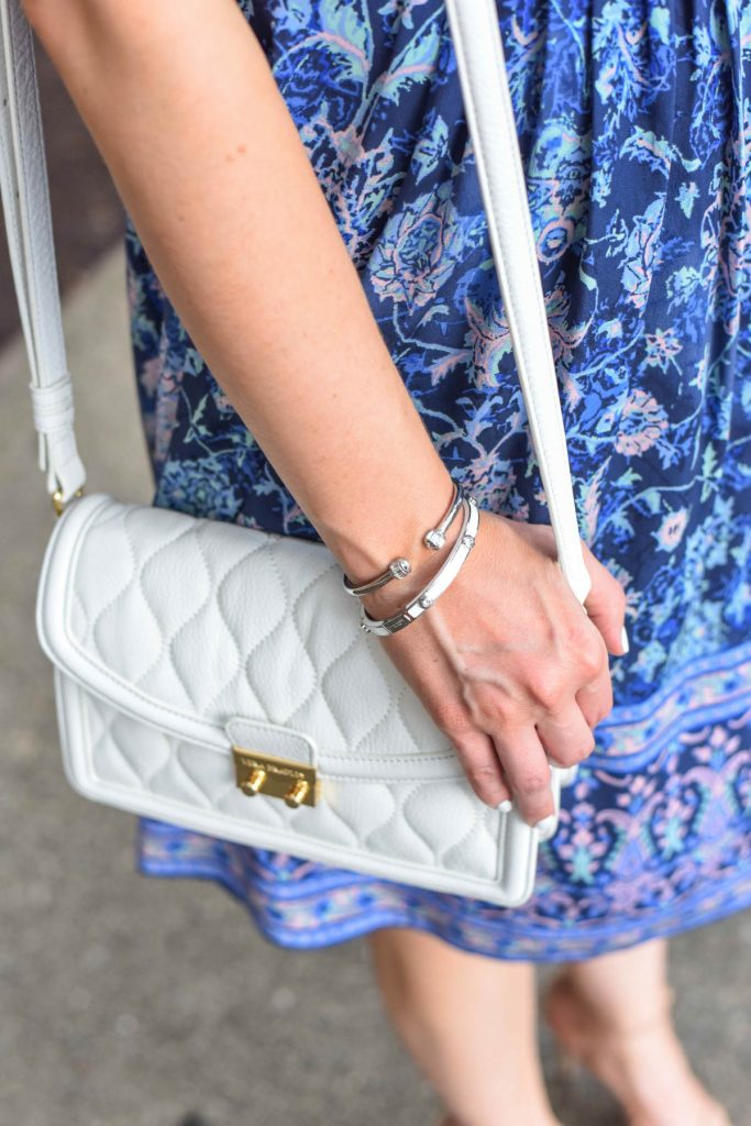henri bendel silver bracelets and white purse