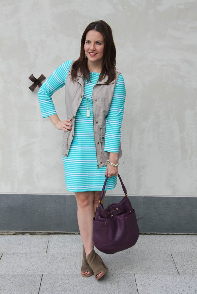 Fall outfit idea featuring a turquoise shift dress and khaki utility dress.