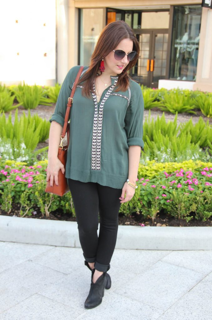 LadyinViolet in a Fall transitional outfit featuring an olive tunic, black skinny jeans and booties