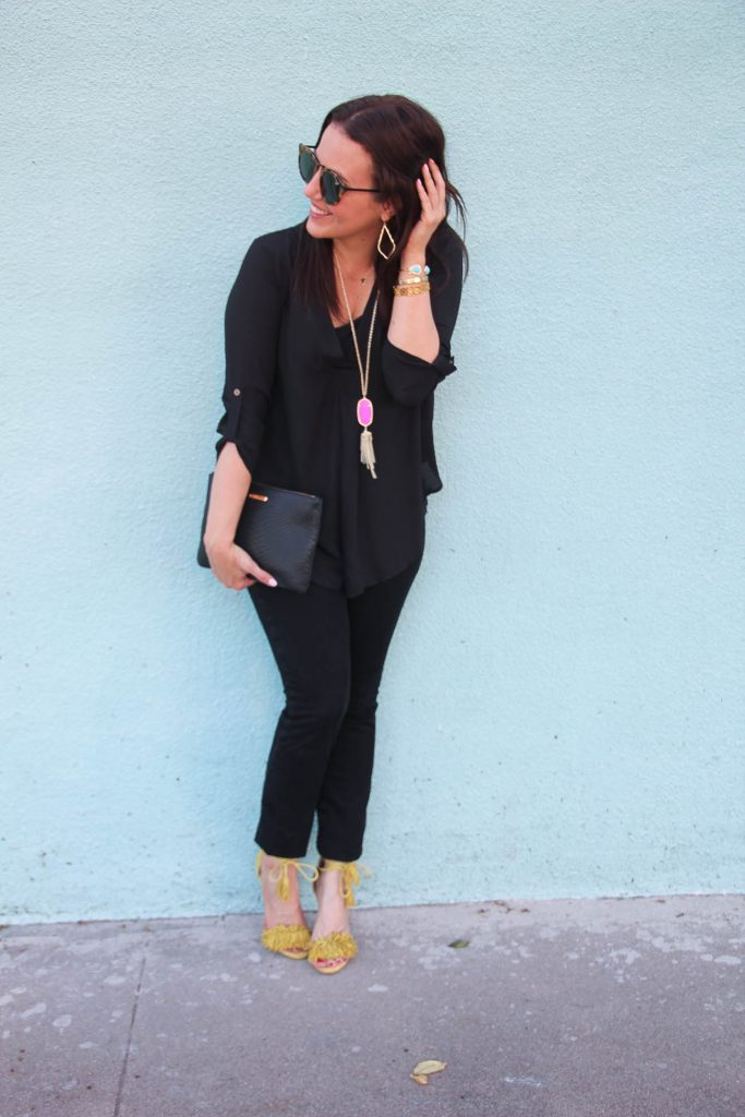Houston Fashion Blogger wearing a chic black outfit featuring pink jewelry.