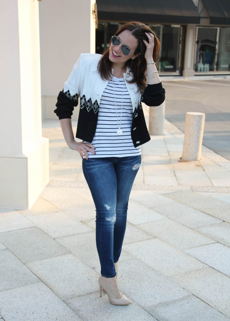 Karen Rock of LadyinViolet wears a striped tee and distressed jeans casual outfit paired with a sequin vintage jacket.