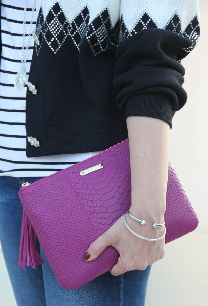 The best clutch for a party - the magenta all in one bag.
