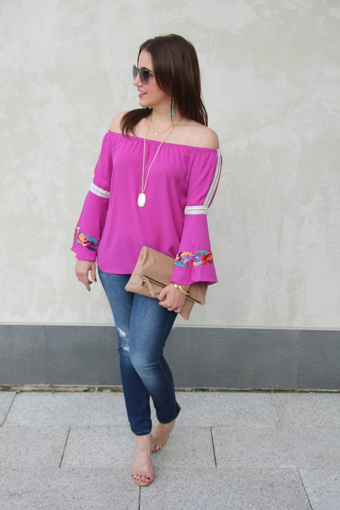 LadyinViolet shares some Houston street style in a bell sleeve blouse and distressed jeans.