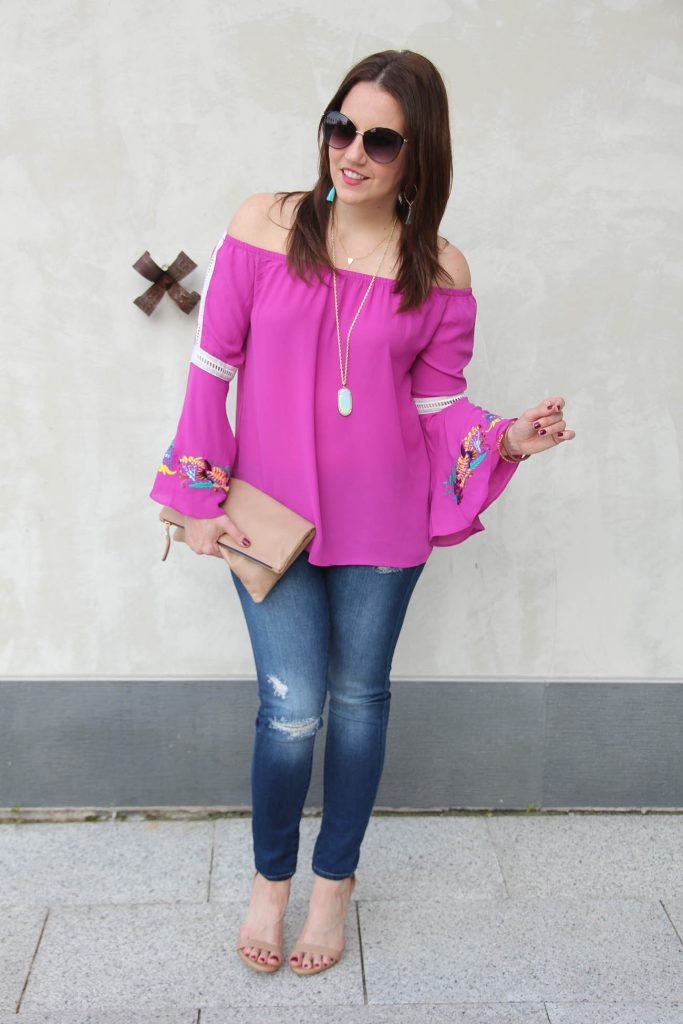 Fashion Blogger Casual Weekend Outfit in distressed skinny jeans and a pink bell sleeve top.