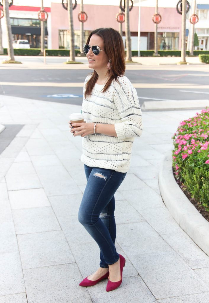 Houston Fashion blogger styles a casual Thanksgiving outfit idea with a sweater.