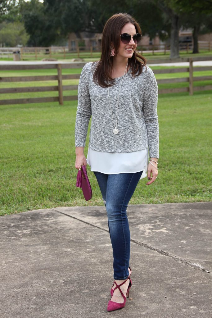 360d729627 Fall outfit idea featuring a faux layered sweater and distressed skinny  jeans.