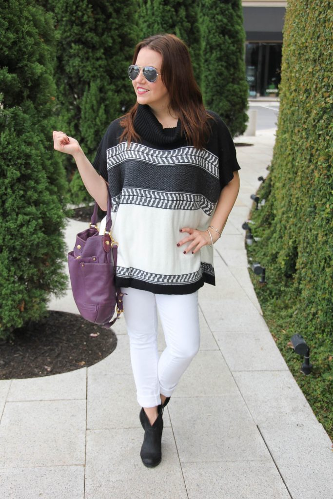 fall outfit idea with white jeans black ankle boots