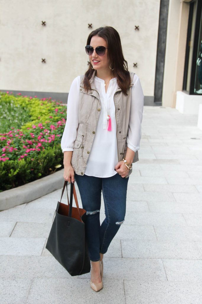 fall weekend outfit with utility vest and white blouse.