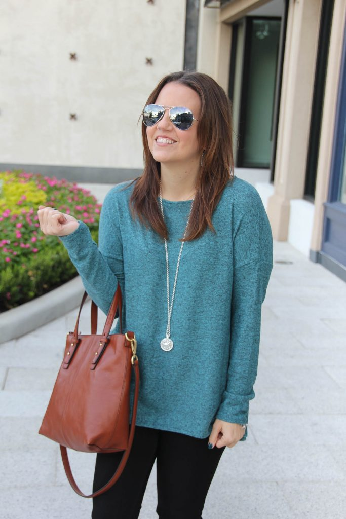 Texas Fashion Blogger wears an oversized teal fleece sweater from Nordstrom.