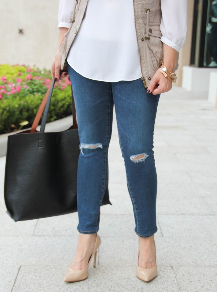 Houston Fashion blogger wears ag distressed skinny jeans with heels.