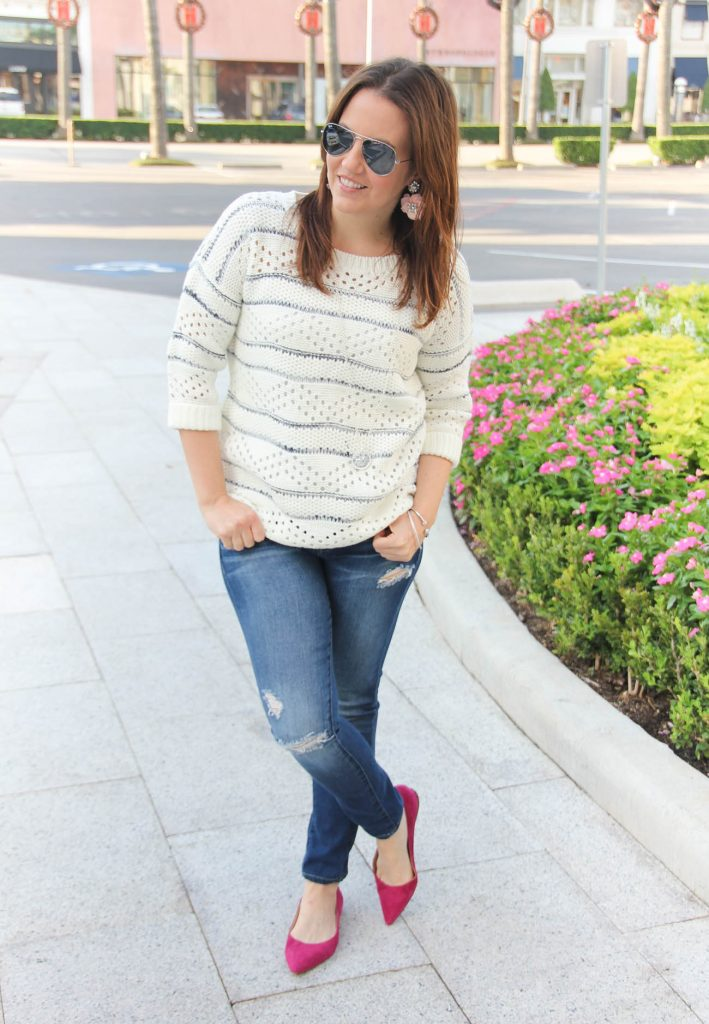 Texas Fashion Blogger wears a casual fall outfit idea with distressed jeans and short sleeve sweater.