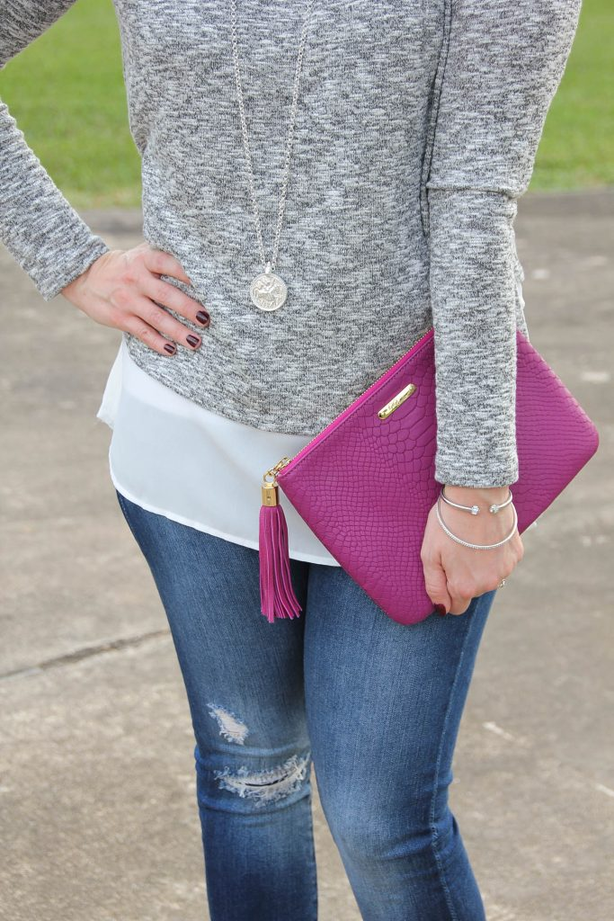LadyinViolet wears a faux layered sweater in gray and white paired with a dark pink clutch.
