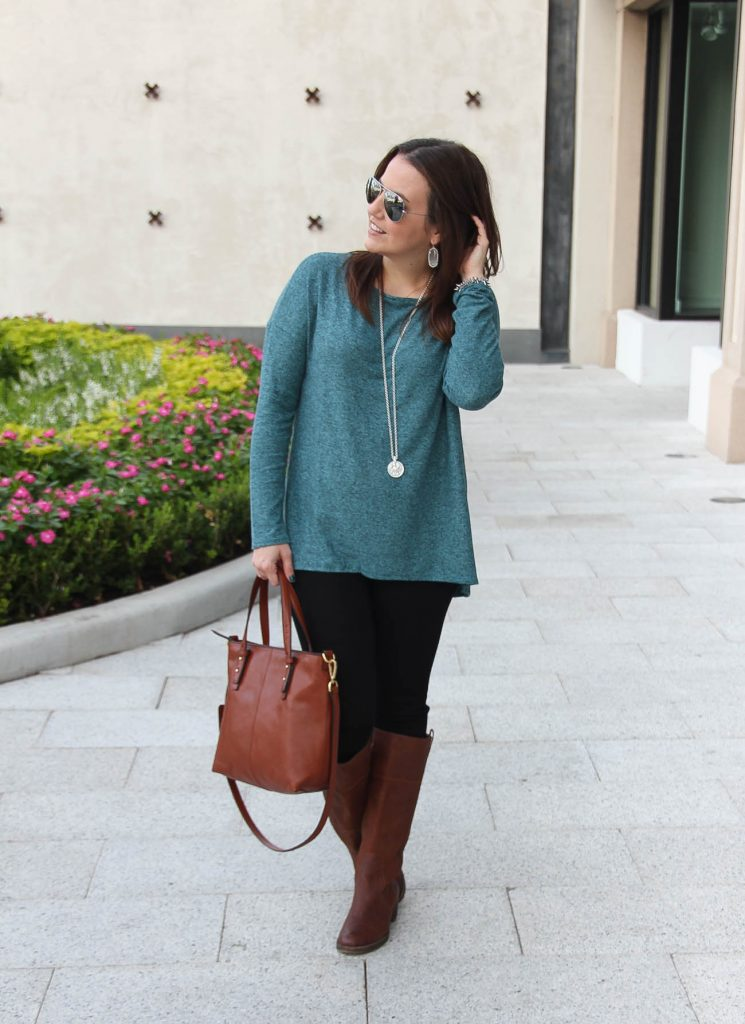 Southern Style Blogger shares a Thanksgiving outfit idea with oversized sweater, black skinny jeans, and riding boots.