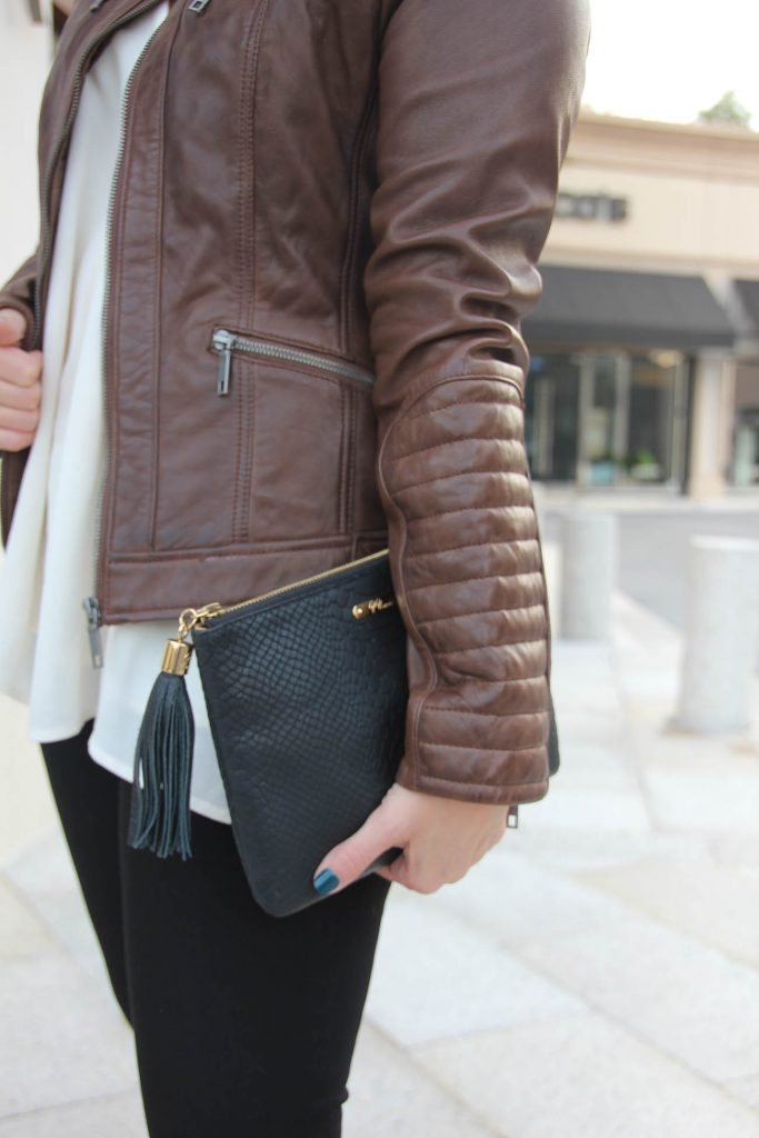 Houston Fashion Blogger wears a Wilsons Leather Brown Leather jacket.