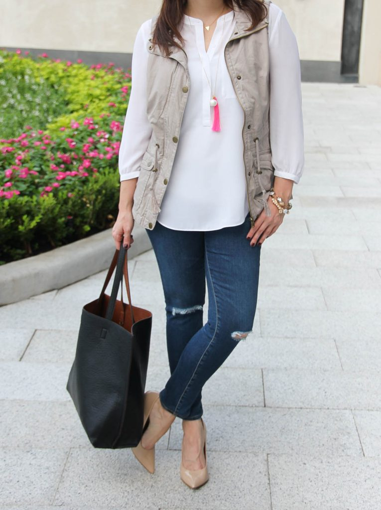fall casual outfit with distressed jeans and utility vest.